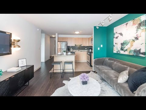 Tour a one-bedroom model at the iconic Aqua apartments