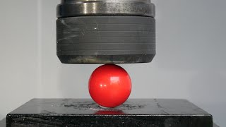 Snooker balls crushed by hydraulic press