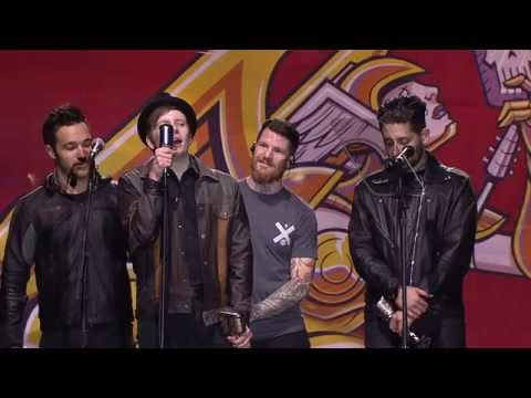 Year - Before closing down the show with the final APMAs performance, Fall Out Boy take home the Artist Of The Year award, presented to them by Head and Ray of Korn.