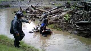 9. Polaris Outlaw 525S in mud hole mrsjr