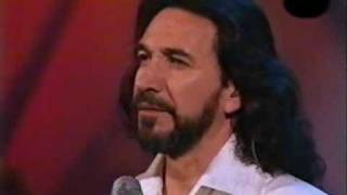 video y letra de Sigue sin mi por Marco Antonio Solis