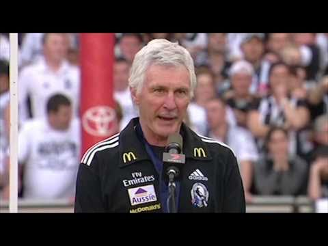 The Collingwood players receive their medals