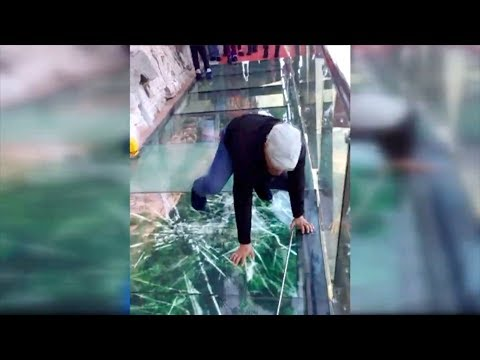 Download Tourist terrified by new glass walkway that cracks under weight HD Mp4 3GP Video and MP3