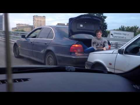 Russian Driver Tows Another Car Thanks To A Spare Tire And A Man Sitting In The