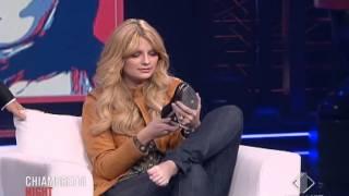 Mischa Barton taking off her shoe during tv show.