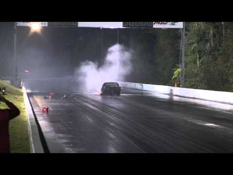 Camaro hits wall after wheelstand in drag race