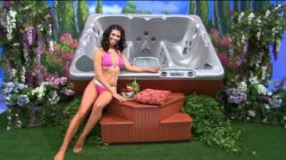 Gwendolyn Osborne in a Pink bikini showing a spa.