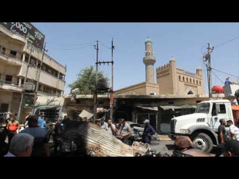 فيديو للمذبحة التي نفذها تنظيم داعش باستخدام سيارة مفخخة في حي الكرادة ببغداد يوم 30 أيار/مايو. [محمد غندور، صباح عرار/تليفزيون وكالة الصحافة الفرنسية/وكالة الصحافة الفرنسية].