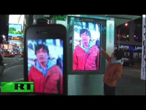 hacked - Check out this footage of a man who uses his iPhone to hack into Times Square video screens, it seems pretty easy doesn't it? Courtesy: http://www.youtube.co...