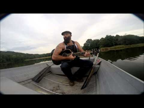 Front Porch Sessions: Rev. Peyton performs amazing finger style guitar tricks on a boat.