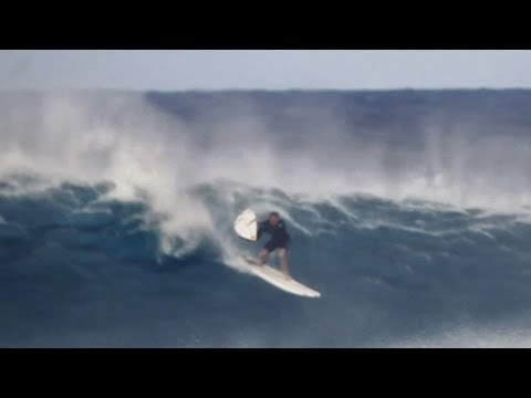 job - Jamie O'Brien tries a new technique by paddling out on his longboard and then dropping in his short board to ride the wave. Later, despite despite the warnin...