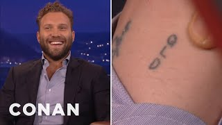 Video Jai Courtney Lost A Tattoo Bet With Margot Robbie  - CONAN on TBS MP3, 3GP, MP4, WEBM, AVI, FLV Mei 2018