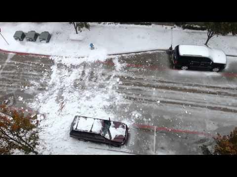Ice avalanche destroys car in Texas