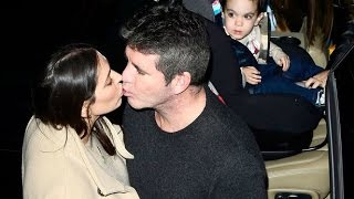 Simon Cowell & Lauren Silverman pucker up as son Eric watches on in awe