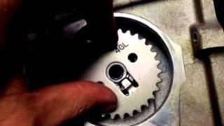 8. Yamaha TT-R90 Cam sprocket and camshaft. TTR90