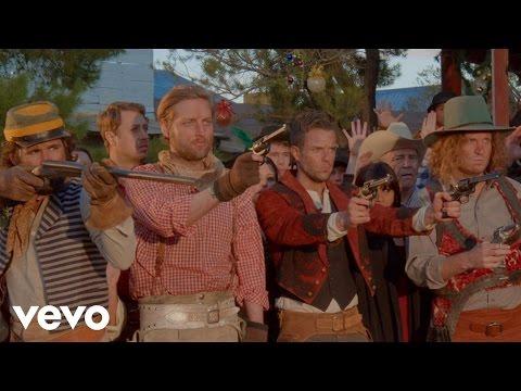 Tekst piosenki The Killers - The Cowboys Christmas' Ball po polsku