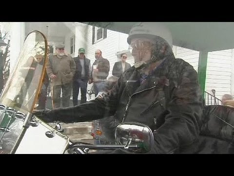 Buried in SEE THROUGH casket- on a motorcycle??