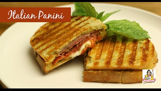 "Join Amy as she makes an Italian Panini Sandwich on the Cuisinart Griddler GR-4N. This panini started with pesto and is stuffed with Italian meats: Mortadella, Capocollo, and Rosmarino. It is then topped with fresh mozzarella, olives, banana peppers, and tomatoes. It is grilled panini style on the Cuisinart Griddler. It is fantastic! Amy Learns to Cook is all about learning to make simple, tasty food from fresh ingredients.  One year ago, I made a commitment to stop eating processed convenience foods.  I decided to learn to cook ""real"" food. Join me!  Let's learn to cook together! Enjoy! Please share! Cuisinart Griddler GR-4N:http://amzn.to/2lyIeGUCuisinart Griddler Deluxe GR-300WS: http://amzn.to/2l9wnOrPlease SUBSCRIBE to my channel, LIKE, and leave a COMMENT.Please visit my website: www.amylearnstocook.comAny links in this description, including Amazon, are affiliate links.Italian Morning by Twin Musicom is licensed under a Creative Commons Attribution license (https://creativecommons.org/licenses/by/4.0/) Artist: http://www.twinmusicom.org/ Bushwick Tarentella Loop by Kevin MacLeod is licensed under a Creative Commons Attribution license (https://creativecommons.org/licenses/by/4.0/) Source: http://incompetech.com/music/royalty-free/index.html?isrc=USUAN1300003 Artist: http://incompetech.com/ Italian Afternoon by Twin Musicom is licensed under a Creative Commons Attribution license (https://creativecommons.org/licenses/by/4.0/) Artist: http://www.twinmusicom.org/"