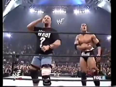 stone cold returns and saves the rock iwrestling the rock