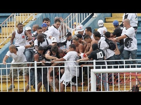 football - Brazilian police fire rubber bullets as violence flares at football match Subscribe to the Guardian HERE: http://bitly.com/UvkFpD Police fire rubber bullets ...