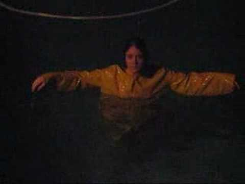 Rainweargirl - Putting on a used yellow rainsuit made from thick slippery plastic and then taking a swim while dressed in it.