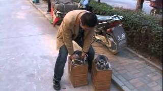 Chinese Man Walks With 400kg Shoes