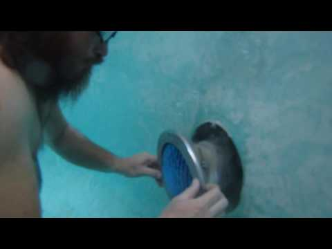Extract stripped screw from pool light under water