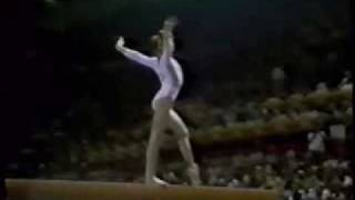 Nadia winning her 3rd gold medal in 1976 Montreal olympics. Scoring her third perfect ten on the  BB in the EF.