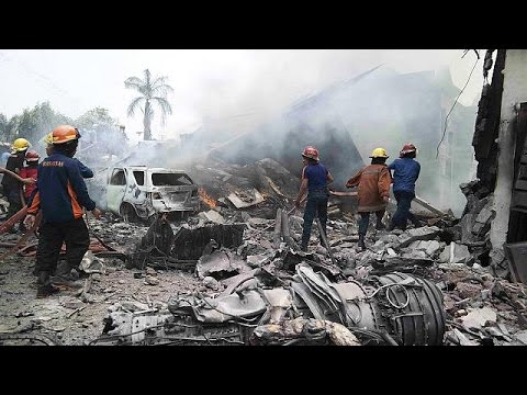 At least 116 people were killed on Tuesday when an Indonesian air force transport plane crashed into a major city shortly after take-off and exploded in a fireball, officials said.