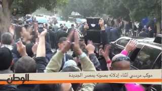 موكب مرسي أثناء إدلائه بصوته بمصر الجديدة