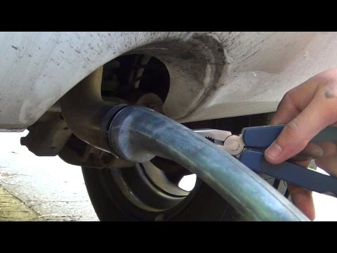 Guy puts rubber tubing over his exhaust pipe