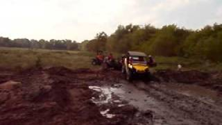 6. 2011 Can-Am Commander 1000 XT on 29.5 outlaws in a mud bog