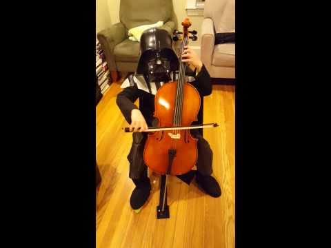 Kid dressed as Darth Vader performs own theme song on