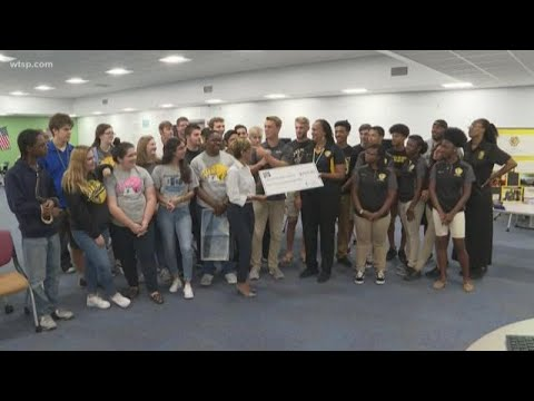 Duke Energy Florida presents check to Lakewood High School