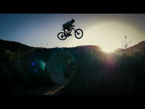 YouTube placeholder image shows biker jumping over a tube at the park.