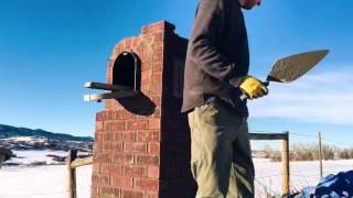 timelapse of brick mail box being built