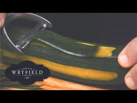 Relaxing Footage of a Zucchini Being Peeled in