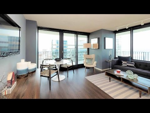 Tour a 2-bedroom model at the iconic Aqua apartment tower