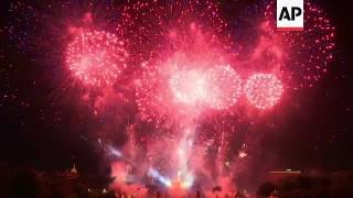 (15 Jul 2017) Bastille Day in Paris ended with a spectacular 30 minutes-long fireworks display at the Eiffel tower.But before the people of Paris could enjoy the display, a minute of silence was held for the victims of the attack in Nice a year ago when a huge truck barrelled down a famed beachside promenade, running over people awaiting the fireworks on France's national day.The Eiffel Tower fireworks were divided into minute-long sections, all of which had their own accompanying soundtrack ranging from Frank Sinatra to modern electro sound and classical music.You can license this story through AP Archive: http://www.aparchive.com/metadata/youtube/984c0088c5e1e5e762ae99cb89d0e669 Find out more about AP Archive: http://www.aparchive.com/HowWeWork