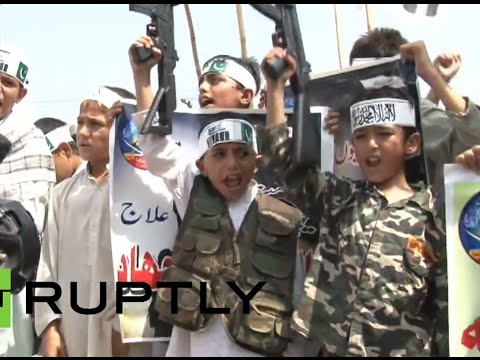 Children - Dozens of young boys from the banned extremist group Jammat-ud-Dawa staged an anti-Israel protest in Peshawar on Tuesday. The boys held a large banner on which was written,