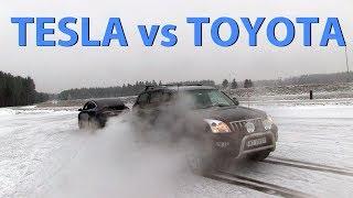Эпическая битва: Toyota Лэнд Круизер против Tesla Model X