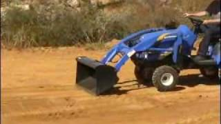 10. New Holland Boomer Spreading and Grading