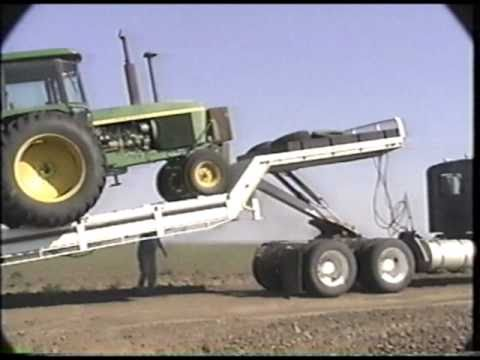 Landoll tilt bed trailer loading the tractor