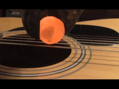 Placing a Red Hot Nickel Ball on Guitar Strings