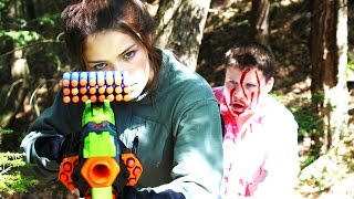 In this episode of Nerf Zombies, Anna is armed with a Nerf gun and is being chased through the woods by zombies. Will she survive?FOLLOW MY VLOG CHANNEL: https://www.youtube.com/user/annakouskyI am going to start posting new vlogs every other day this summer (starting June)  so be sure to subscribe! FOLLOW ME ON SOCIAL MEDIAInstagram ► http://instagram.com/annakouskyTwitter ► http://twitter.com/annakousky----------------------------------------------------------------~ About Goober Media ~My name is Anna Kousky and I'm the director of Goober Media. I film all kinds of awesome Nerf Wars with my siblings.I'm currently in high school and I put a lot of effort into producing at least one NEW video every Saturday! When I'm not filming I'm either playing soccer, snowboarding, or eating a nice juicy piece of fruit (I love fruit haha). I come from a big family and have 6 other siblings! It's crazy fun. My brother Paul owns the famous Nerf channel PDKfilms, and I act in a lot of his Nerf videos as well. Here's a list of all my brothers and sisters so you can get to know the fam... Chad, Paul, Eric, Anna (me), James, Chris, and Eva. Most of my Nerf content consists of Nerf First Person Shooters, Funny and Intense Nerf Wars, and plenty of unique Nerf battles that I'm sure you'll love. Enjoy my friends, and Subscribe to Goober Nation!----------------------------------------------------------------------------