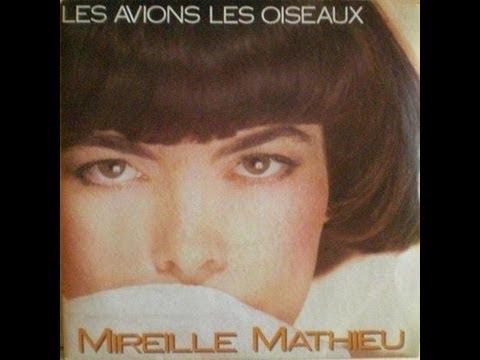 Tekst piosenki Mireille Mathieu - Est-Ce Qu'Il Parle Encore De Moi po polsku