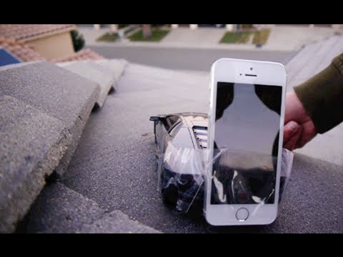 Off - RC Lamborghini Reventon attached to an iPhone 5S drives off the roof of my house. FACEBOOK: https://www.facebook.com/pages/TechRax/192119757502890 TWITTER: h...