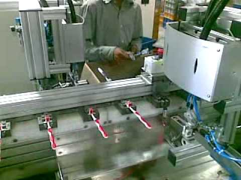 Brush Loading Machine - Trimming Operation
