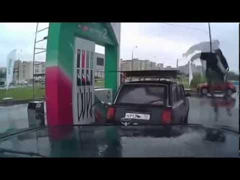 Russian Gas Station Attendant Break Dancing On A Car