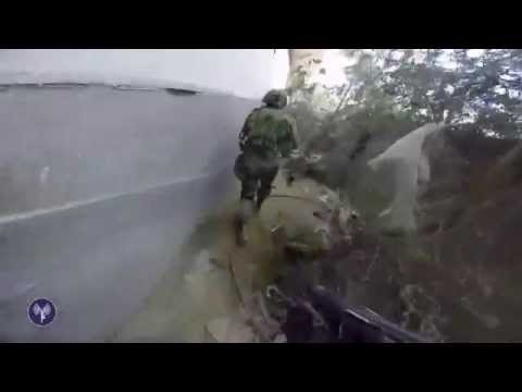 footage - First-person footage from the field of IDF special forces storming a terrorist building in Shuja'iya. They seize a stockpile of weapons and uncover a tunnel opening. For more from the IDF:...
